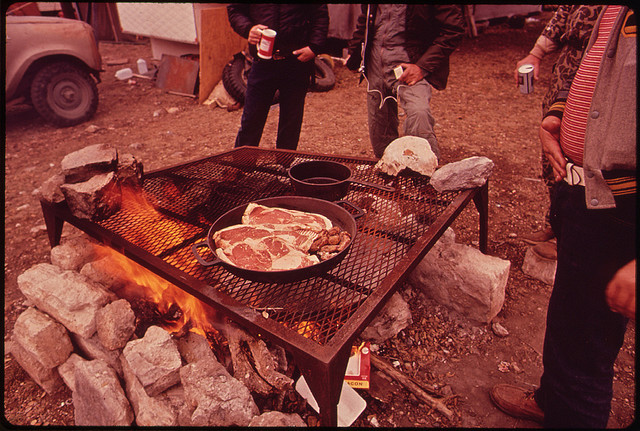 Grilling steaks at camp