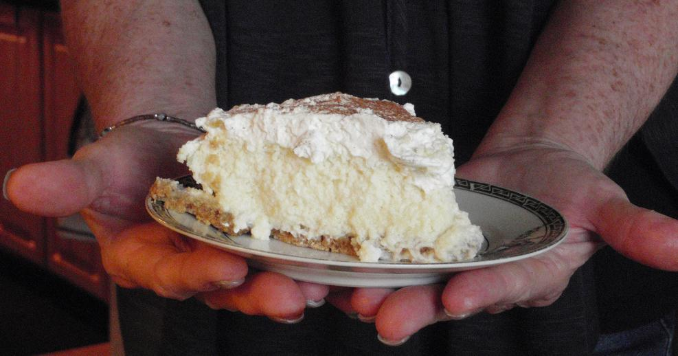 Glenda Facemire holding a slice of her favorite key lime pie