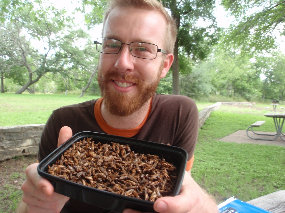 Robert Nathan Allen, founder of Little Herds, with a container of toasted crickets. Photo © Cecilia Nasti.