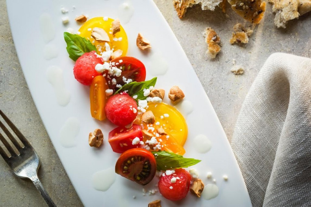 Tomato Salad with Watermelon, Toasted Cashews, Chèvre, and Lemon-Agave Vinaigrette
